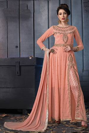 A Must Have Shade In Every Womens Wardrobe Is Here With This Designer Suit In Peach Color. Its Heavy Embroidered Top Is Fabricated On Georgette Paired With Jacquard Silk Bottom And Chiffon Fabricated Dupatta. Its Lovely Front Slit Pattern Will Give An Enhanced Look To Your Personality.