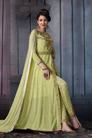 A Must Have Shade In Every Womens Wardrobe Is Here With This Designer Suit In Light Green Color. Its Heavy Embroidered Top Is Fabricated On Georgette Paired With Jacquard Silk Bottom And Chiffon Fabricated Dupatta. Its Lovely Front Slit Pattern Will Give An Enhanced Look To Your Personality.
