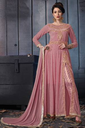 A Must Have Shade In Every Womens Wardrobe Is Here With This Designer Suit In Pink Color. Its Heavy Embroidered Top Is Fabricated On Georgette Paired With Jacquard Silk Bottom And Chiffon Fabricated Dupatta. Its Lovely Front Slit Pattern Will Give An Enhanced Look To Your Personality.