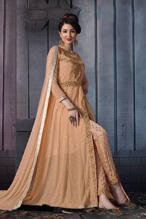 A Must Have Shade In Every Womens Wardrobe Is Here With This Designer Suit In Beige Color. Its Heavy Embroidered Top Is Fabricated On Georgette Paired With Jacquard Silk Bottom And Chiffon Fabricated Dupatta. Its Lovely Front Slit Pattern Will Give An Enhanced Look To Your Personality.
