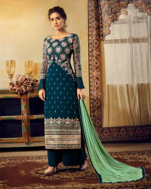 Grab This Very Beautiful Designer Heavy Embroidered Straight Suit In Blue Color Paired With Contrasting Sea Green Colored Dupatta. Its Heavy Embroidered Top Is Fabricated On Georgette Paired With Santoon Bottom And Chiffon Fabricated Dupatta.