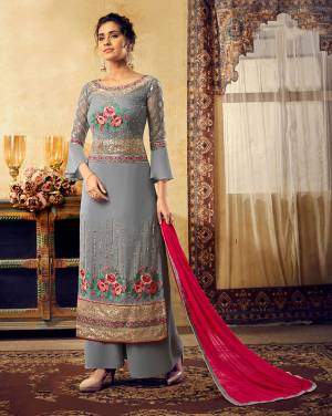 Flaunt Your Rich and Elegant Taste Wearing This Heavy Designer Suit In Grey Color Paired With Contrasting Dark Pink Colored Dupatta. Its Top Is Georgette Based Paired With Santoon Bottom And Chiffon Fabricated Dupatta. Buy Now.