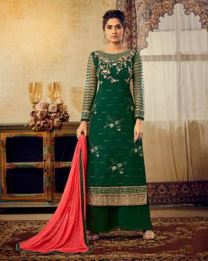 Celebrate This Festive Season With Beauty And Comfort Wearing This Designer Straight Suit In Dark Green Color Paired With Contrasting Crimson Red Colored Dupatta. Its Pretty Embroidered Georgette Based Top Is Paired With Santoon Bottom And Chiffon Fabricated Dupatta.