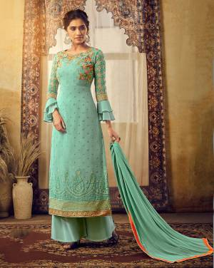 You Will Definitely Earn Lots Of Compliments Wearing This Heavy Designer Suit In Turquoise Blue Color Paired With Turquoise Blue Colored Bottom And Dupatta. Its Top Is Fabricated On Georgette Beautified With Heavy Embroidery Paired With Santoon Bottom And Chiffon Fabricated Dupatta.