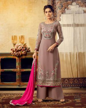 New And Unique Shade Is Here To Add Into Your Wardrobe With This Heavy Designer Straight Suit In Mauve Color Paired With Contrasting Dark Pink Colored Dupatta. Its Top IS Georgette Based Paired With Santoon Bottom And Chiffon Fabricated Dupatta.