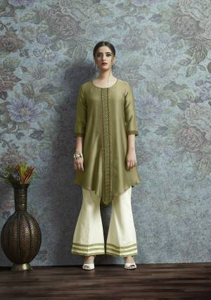Here Is New And Unqiue With This Designer Semi-Stitched Kurti With Bottom In Indo-Western Wear. Its Pretty Modal Satin Fabricated Kurti Is In Olive Green Color Paired With Off-White Colored Unstitched Cotton Fabricated Bottom.