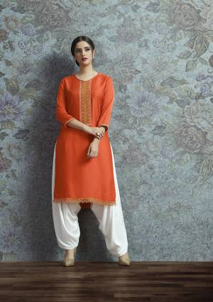 Celebrate This Festive Season With A New Indo-Western Look Wearing This Pair Of Kurti In Orange Color Paired With White Colored Bottom. Its Top Is Fabricated On Modal Satin Beautified With Embroidered Lace Border Paired With Crepe Fabricated Unstitched Bottom. Buy This Lovely Pair Now.