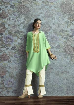 Here Is New And Unqiue With This Designer Semi-Stitched Kurti With Bottom In Indo-Western Wear. Its Pretty Modal Satin Fabricated Kurti Is In Light Green Color Paired With Off-White Colored Unstitched Cotton Fabricated Bottom.