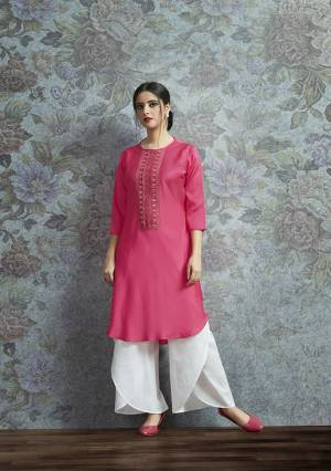 Celebrate This Festive Season With A New Indo-Western Look Wearing This Pair Of Kurti In Rani Pink Color Paired With White Colored Bottom. Its Top Is Fabricated On Modal Satin Beautified With Embroidered Lace Border Paired With Crepe Fabricated Unstitched Bottom. Buy This Lovely Pair Now.