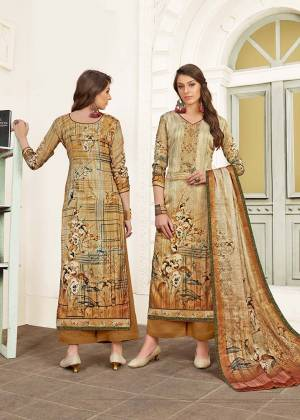 Flaunt Your Rich And Elegant Taste In This Designer Straight Suit In Beige Color. Its Top Is Fabricated On Modal Satin Paired With Satin Bottom And Chiffon Fabricated Dupatta. It Is Beautified With Digital Prints And Thread Work.