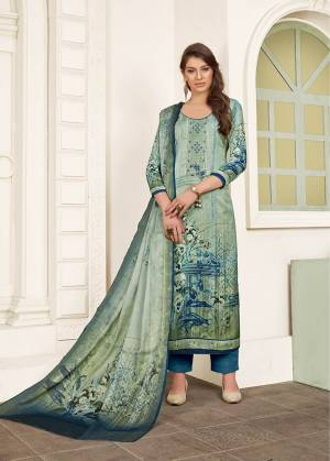 Celebrate This Festive Season With Beauty And Comfort Wearing This elegant Looking Straight Suit In Mint Green Colored Top And Dupatta Paired With Contrasting Blue Colored Bottom. Its Top And Bottom Are Satin Based Paired With Chiffon Fabricated Dupatta. Buy This Semi-Stitched Suit Now.