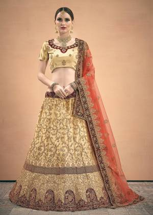 Evergreen Combination Is Here With This Heavy Designer Lehenga Choli In Cream Color Paired With Red Colored Dupatta. Its Blouse And Lehenga Are Fabricated On Satin Paired With Net Fabricated Dupatta. Buy Now.