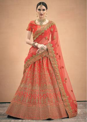 Adorn The Pretty Angelic Look Wearing This Designer Lehenga Choli In All Over Red Color. This Lehenga Choli Is Satin Based Paired With Net Fabricated Dupatta.