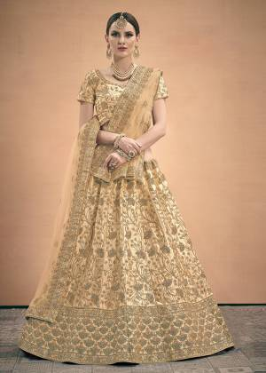 Flaunt Your Rich And Elegant Taste In This Pretty Embroidered Lehenga Choli In All Over Cream Color. This Lehenga Choli Is Satin Fabricated Beautified With Heavy Embroidery Paired With Net Fabricated Dupatta.