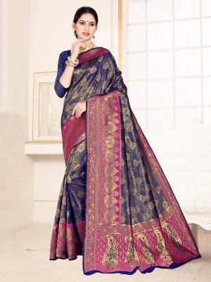 Grab This Designer Silk Based Saree In Navy Blue Color Paired With Dark Pink Colored Blouse. This Saree And Blouse Are Fabricated On Banarasi Art Silk Beautified With Weave All Over. Buy Now.
