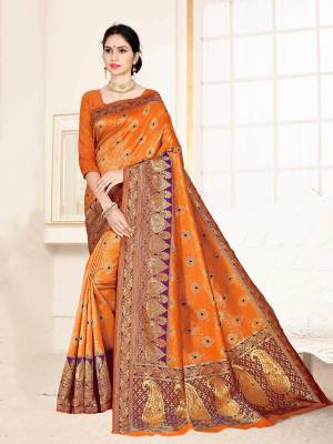 Grab This Designer Silk Based Saree In Orange Color Paired With Dark Pink Colored Blouse. This Saree And Blouse Are Fabricated On Banarasi Art Silk Beautified With Weave All Over. Buy Now.