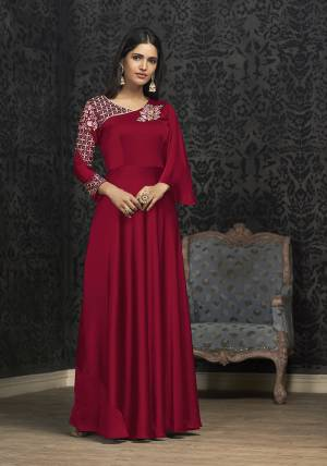 Here Is A Solution For Your Party Wear Dresses With This Designer Readymade Gown In Dark Pink Color Fabricated On Glowing Georgette. It Has Very Beautiful Pattern With Detailed Embroidery And Available In All Regular Sizes. Buy Now.