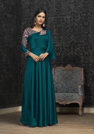 Here Is A Solution For Your Party Wear Dresses With This Designer Readymade Gown In Teal Blue Color Fabricated On Glowing Georgette. It Has Very Beautiful Pattern With Detailed Embroidery And Available In All Regular Sizes. Buy Now.