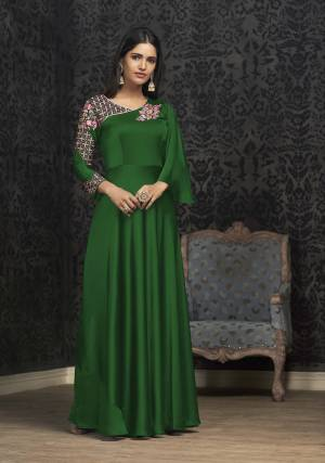 Here Is A Solution For Your Party Wear Dresses With This Designer Readymade Gown In Dark Green Color Fabricated On Glowing Georgette. It Has Very Beautiful Pattern With Detailed Embroidery And Available In All Regular Sizes. Buy Now.
