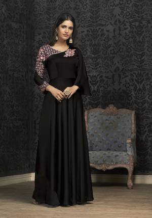 Here Is A Solution For Your Party Wear Dresses With This Designer Readymade Gown In Black Color Fabricated On Glowing Georgette. It Has Very Beautiful Pattern With Detailed Embroidery And Available In All Regular Sizes. Buy Now.
