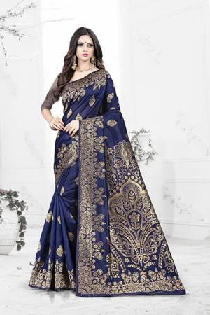 Enhance Your Personality Wearing This Rich Silk Based Designer Saree In Navy Blue Color Paired With Navy Blue Colored Blouse. This Saree Is Beautified With Bold Weave Giving It An Enhanced Look.