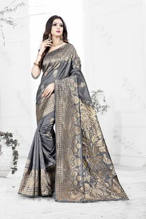 Enhance Your Personality Wearing This Rich Silk Based Designer Saree In Grey Color Paired With Navy Blue Colored Blouse. This Saree Is Beautified With Bold Weave Giving It An Enhanced Look.