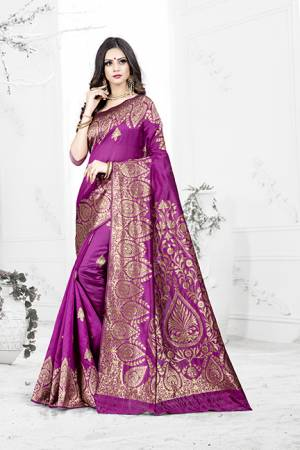 Enhance Your Personality Wearing This Rich Silk Based Designer Saree In Light Purple Color Paired With Navy Blue Colored Blouse. This Saree Is Beautified With Bold Weave Giving It An Enhanced Look.