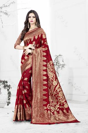 Enhance Your Personality Wearing This Rich Silk Based Designer Saree In Red Color Paired With Navy Blue Colored Blouse. This Saree Is Beautified With Bold Weave Giving It An Enhanced Look.