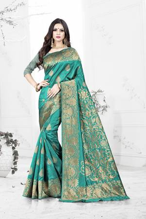 Enhance Your Personality Wearing This Rich Silk Based Designer Saree In Turquoise Blue Color Paired With Navy Blue Colored Blouse. This Saree Is Beautified With Bold Weave Giving It An Enhanced Look.