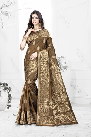 Enhance Your Personality Wearing This Rich Silk Based Designer Saree In Brown Color Paired With Navy Blue Colored Blouse. This Saree Is Beautified With Bold Weave Giving It An Enhanced Look.