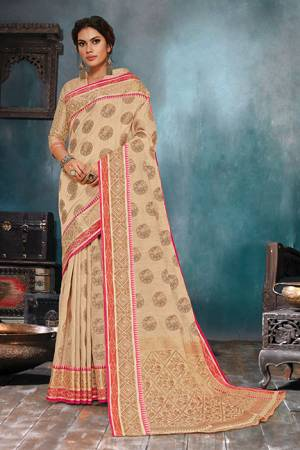 Flaunt Your Rich And Elegant Taste In This Elegant Looking Cream Colored Saree. This Saree Is Fabricated On Handloom Cotton Silk Paired With Jacquard Silk Fabricated Blouse. It Is Beautified With Weave Giving An Enhanced Look.