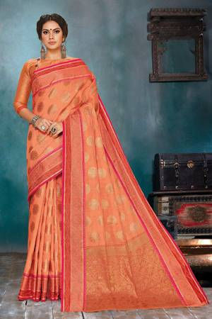 Celebrate This Festive Season In A Very Elegant Look With This Silk Based Orange Colored Saree. This Saree IS Fabricated On Handloom Cotton Silk Paired With Jacquard Silk Fabricated Blouse.