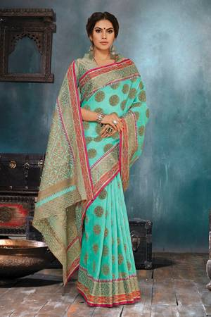 Flaunt Your Rich And Elegant Taste In This Elegant Looking Turquoise Blue Colored Saree. This Saree Is Fabricated On Handloom Cotton Silk Paired With Jacquard Silk Fabricated Blouse. It Is Beautified With Weave Giving An Enhanced Look.