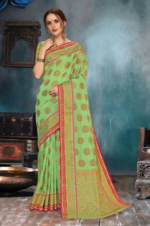 Flaunt Your Rich And Elegant Taste In This Elegant Looking Light Green Colored Saree. This Saree Is Fabricated On Handloom Cotton Silk Paired With Jacquard Silk Fabricated Blouse. It Is Beautified With Weave Giving An Enhanced Look.