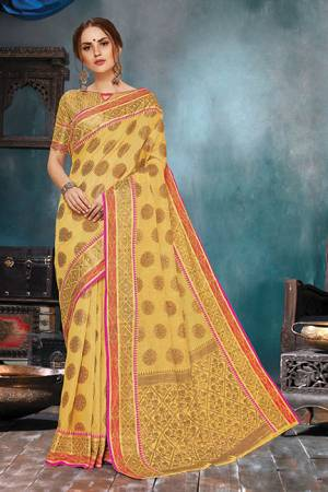 Celebrate This Festive Season In A Very Elegant Look With This Silk Based Occur Yellow Colored Saree. This Saree IS Fabricated On Handloom Cotton Silk Paired With Jacquard Silk Fabricated Blouse.
