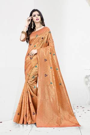 Shine Bright In This Designer Silk Based Saree In Orange Color Paired With Orange Colored Blouse. This Saree Is Fabricated On Weaving Silk Paired With Art Silk Fabricated Blouse. It Has Rich Fabric Beautified With Detailed Weave All Over. Buy Now.
