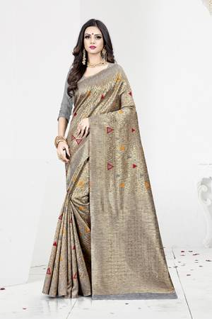 Shine Bright In This Designer Silk Based Saree In Grey Color Paired With Grey Colored Blouse. This Saree Is Fabricated On Weaving Silk Paired With Art Silk Fabricated Blouse. It Has Rich Fabric Beautified With Detailed Weave All Over. Buy Now.