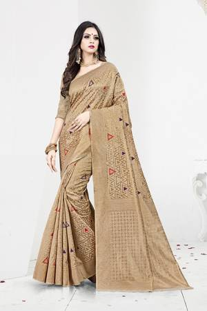 Shine Bright In This Designer Silk Based Saree In Beige Color Paired With Beige Colored Blouse. This Saree Is Fabricated On Weaving Silk Paired With Art Silk Fabricated Blouse. It Has Rich Fabric Beautified With Detailed Weave All Over. Buy Now.