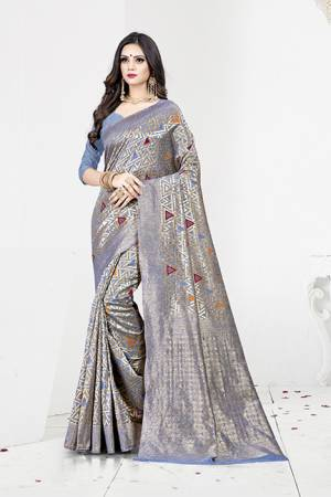 Shine Bright In This Designer Silk Based Saree In Blue Color Paired With Blue Colored Blouse. This Saree Is Fabricated On Weaving Silk Paired With Art Silk Fabricated Blouse. It Has Rich Fabric Beautified With Detailed Weave All Over. Buy Now.