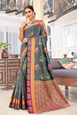 Rich And Elegant Looking Designer Silk Based Saree Is Here In Grey Color Paired With Multi Colored Blouse. It Is Beautified With Print And Weave. Buy Now.