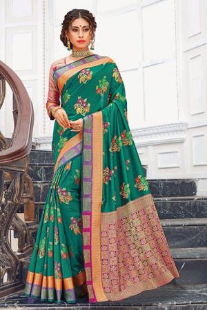Celebrate This Festive Season Wearing This Designer Saree In Teal Green Color Paired With Contrasting Pink Colored Blouse. This Saree And Blouse Are Silk Based Which Gives A Rich Look T Your Personality.