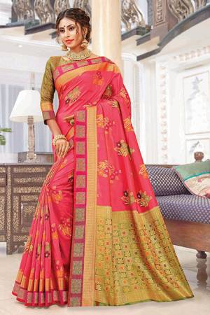 Bright And Appealing Color Is Here With This Silk Based Saree In Dark Pink Color Paired With Contrasting Olive Green Colored Blouse. This Saree Is Weaving Silk Based Paired With Jacquard Silk Fabricated Blouse. Its Fabric Is Durable And Easy To Care For.