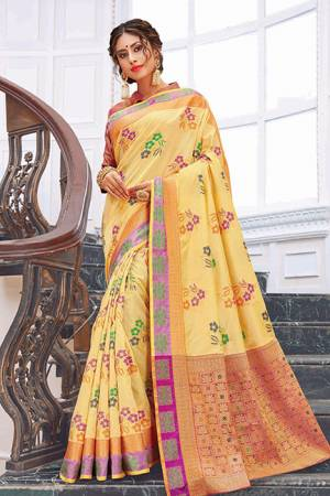 Rich And Elegant Looking Designer Silk Based Saree Is Here In Yellow Color Paired With Pink Colored Blouse. It Is Beautified With Print And Weave. Buy Now.