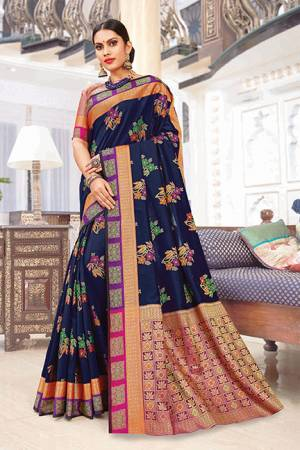 Celebrate This Festive Season Wearing This Designer Saree In Navy Blue Color Paired With Contrasting Pink Colored Blouse. This Saree And Blouse Are Silk Based Which Gives A Rich Look T Your Personality.