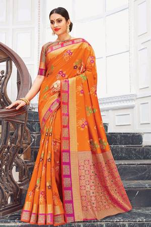 Bright And Appealing Color Is Here With This Silk Based Saree In Orange Color Paired With Contrasting Dark Pink Colored Blouse. This Saree Is Weaving Silk Based Paired With Jacquard Silk Fabricated Blouse. Its Fabric Is Durable And Easy To Care For.
