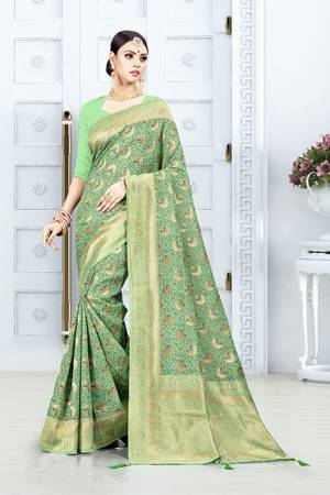 Grab This Pretty Floral Saree In Green Color Paired With Green Colored Blouse. This Saree Is Fabricated On Weaving Silk Paired With Art Silk Fabricated Blouse. This Pretty Saree Is Light Weight, Durable And Easy To Care For.