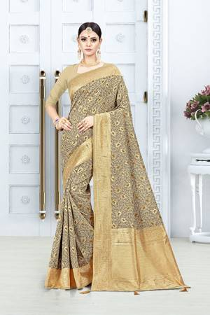 Grab This Pretty Floral Saree In Beige Color Paired With Beige Colored Blouse. This Saree Is Fabricated On Weaving Silk Paired With Art Silk Fabricated Blouse. This Pretty Saree Is Light Weight, Durable And Easy To Care For.