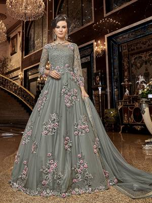 Flaunt Your Rich And Elegant Taste Wearing This Heavy Designer Floor Length Suit In Grey Color. Its Floor Length Top IS Net Based Beautified With Attractive Contrasting Embroidery Paired With Santoon Bottom And Net Fabricated Dupatta.