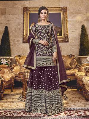 Grab This Very Beautiful Heavy Plazzo Suit In Wine Color Paired With Wine Colored Bottom And Dupatta. Its Top, Bottom And Dupatta Are Fabricated On Net Beautified With Heavy Embroidery.