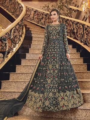 Wear This Heavy Designer suit In Two Looks With This Beautiful Dark Grey Colored Floor Length Suit Paired With A Net Fabricated Embroidered Jacket, Art Silk Fabricated Bottom And Net Fabricated Dupatta. You Can Wear This With Or Without Jacket As Per The Ocaasion.